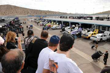 Fans watch NASCAR Sprint Cup Series teams prepare for a day of testing at Phoenix International Raceway in Avondale, Ariz - Photo Credit: Norm Hall/Getty Images for NASCAR