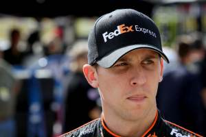 Denny Hamlin in Garage - Photo Credit: Jerry Markland/Getty Images for NASCAR