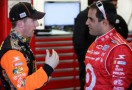 Earnhardt Ganassi Racing teammates Jamie McMurray & Juan Pablo Montoya in garage - Photo Credit: Nick Laham/Getty Images for NASCAR