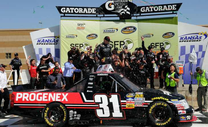 James Buescher celebrates in Kansas Speedway Victory Lane after getting his first career NASCAR Camping World Truck Series win in the SFP 250 on Saturday in Kansas City, Kan. - Photo Credit: John Harrelson/Getty Images for NASCAR