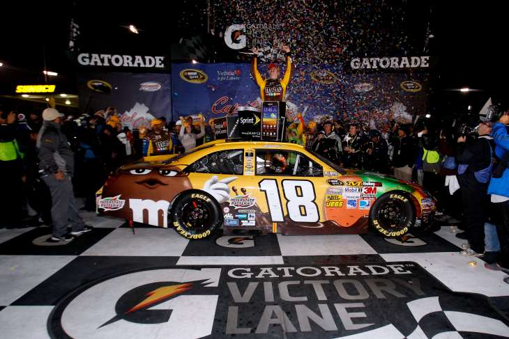 Kyle Busch celebrates winning his fourth consecutive spring race at Richmond International Raceway on Saturday. - Photo Credit: Sean Gardner/Getty Images for NASCAR