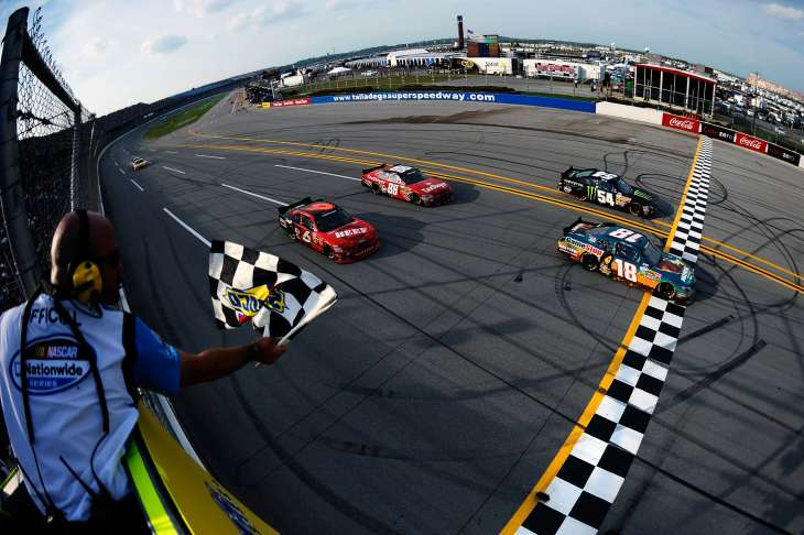 Joey Logano, driver of the #18 GameStop Toyota, crosses the finish line ahead of Kyle Busch Ricky Stenhouse Cole Whitt to win the NASCAR Nationwide Series Aaron's 312 at Talladega Superspeedway on Saturday in Talladega, Ala. - Photo Credit: Jared C. Tilton/Getty Images for NASCAR