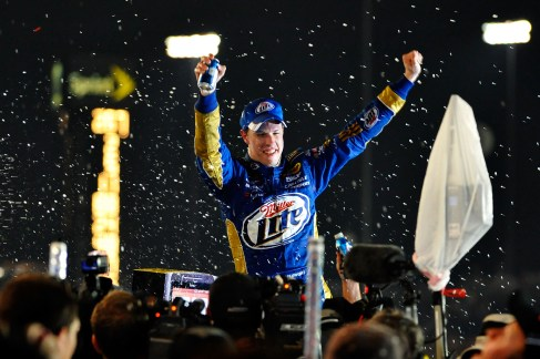 Brad Keselowski, driver of the No. 2 Miller Lite Dodge, celebrates in Victory Lane after winning the NASCAR Sprint Cup Series Quaker State 400 at Kentucky Speedway on Saturday in Sparta, Ky. - Photo Credit: Rainier Ehrhardt/Getty Images for NASCAR
