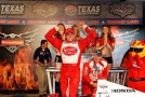 FORT WORTH, TX - JUNE 09: Justin Wilson of England, driver of the #18 Sonny's BBQ Honda Dallara, celebrates in Victory Lane after winning the IZOD IndyCar Series Firestone 550 at Texas Motor Speedway on June 9, 2012 in Fort Worth, Texas. (Photo by Chris Graythen/Getty Images)