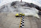 Joey Logano, driver of the #18 Dollar General Toyota, burns out to celebrate winning the NASCAR Nationwide Series 5-hour Energy 200 at Dover International Speedway on June 2, 2012 in Dover, Delaware. (Photo by Todd Warshaw/Getty Images)
