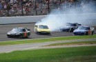 Joey Logano (No. 20 Dollar General Toyota) Spins in front of Matt Kenseth - Photo Credit: Mike Young for IMS