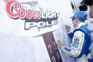 Mark Martin signs the Coors Light Pole board after winning the Coors Light Pole for the Pure Michigan 400 at Michigan International Speedway. - Photo Credit: Todd Warshaw/Getty Images for NASCAR