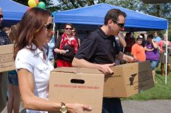 Kyle And Samantha Busch Visit Barium Springs In Statesville, North Carolina To Deliver Donated Food