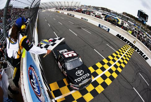 Denny Hamlin, driver of the #51 Toyota Toyota, races past the checkered flag to win the NASCAR Camping World Truck Series Kroger 200 at Martinsville Speedway on October 27, 2012 in Ridgeway, Virginia. - Photo Credit: Streeter Lecka/Getty Images
