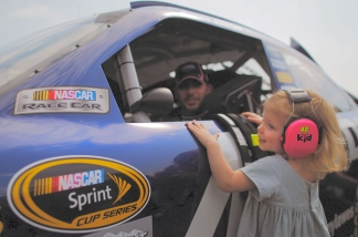 Jimmie Johnson, driver of the #48 Lowe's Chevrolet, looks at his daughter Genevieve Marie on the grid - Photo Credit: Tom Pennington/Getty Image for NASCAR