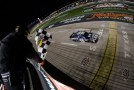 Jimmie Johnson, driver of the #48 Lowe's Chevrolet, crosses the finish line to win the NASCAR Sprint Cup Series AAA Texas 500 at Texas Motor Speedway on November 4, 2012 in Fort Worth, Texas. - Photo Credit: Chris Graythen/Getty Images