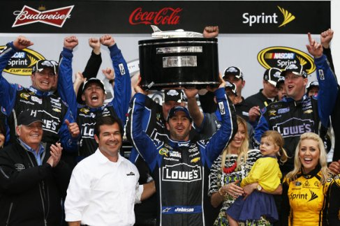 Jimmie Johnson, driver of the #48 Lowe's Chevrolet, hoists the Harley J. Earl trophy after winning the NASCAR Sprint Cup Series Daytona 500 at Daytona International Speedway on February 24, 2013 in Daytona Beach, Florida. - Photo Credit: Chris Graythen/Getty Images