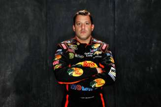 Driver Tony Stewart poses during portraits for the 2013 NASCAR Sprint Cup Series at Daytona International Speedway on February 14, 2013 in Daytona Beach, Florida. - Photo Credit: Nick Laham/Getty Images