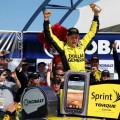Matt Kenseth, driver of the #20 Dollar General Toyota, celebrates in Victory Lane after winning the NASCAR Sprint Cup Series Kobalt Tools 400 at Las Vegas Motor Speedway on March 10, 2013 in Las Vegas, Nevada. - Photo Credit: Todd Warshaw/Getty Images