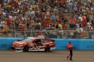 Ryan Newman, driver of the #39 Quicken Loans Chevrolet, jumps out of his car and walks across the track during the NASCAR Sprint Cup Series Subway Fresh Fit 500 at Phoenix International Raceway on March 3, 2013 in Avondale, Arizona. - Photo Credit: Justin Edmonds/Getty Images