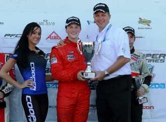 Scott Hargrove and Mazda's John Doonan on the Podium