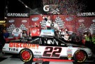 Brad Keselowski, driver of the #22 Discount Tire Ford, celebrates in Victory Lane - Photo Credit: Todd Warshaw/Getty Images
