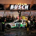 Kyle Busch, driver of the #18 Interstate Batteries Toyota, celebrates in Victory Lane after winning the NASCAR Sprint Cup Series NRA 500 at Texas Motor Speedway on April 13, 2013 in Fort Worth, Texas. - Photo Credit: Jerry Markland/Getty Images