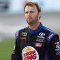 Travis Kvapil, driver of the #93 Dr. Pepper Toyota, walks on the grid - Photo Credit: Ronald Martinez/Getty Images