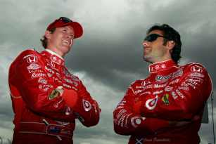 (L-R) Scott Dixon of New Zealand, driver of the #9 Target Chip Ganassi Racing Dallara Honda, chats with teammate Dario Franchitti of Scotland, driver of the #10 Target Chip Ganassi Racing Dallara Honda - Photo Credit: Chris Trotman/Getty Images