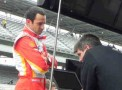 2013 IICS Driver Helio Castroneves and Team Penske Crew Member Going over Data - Photo Credit: Paul Powell/Catchfence