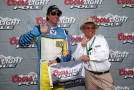 Travis Pastrana, driver of the #60 Roush Fenway Racing Ford, poses with his pole award along with team owner Jack Roush (R) after qualifying firist for the NASCAR Nationwide Series Aaron's 312 at Talladega Superspeedway on May 3, 2013 in Talladega, Alabama. - Photo Credit: Tom Pennington/Getty Images