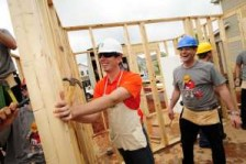 NASCAR driver Kyle Busch and crew chief Dave Rogers help frame a Habitat for Humanity of Charlotte home, as part of M&M'S effort to 'M'Prove America.' The program, which will be featured on Busch's No. 18 M&M'S Toyota this weekend, is designed to fund the construction of Habitat for Humanity homes across the country. (Photo by Grant Halverson/Getty Images for M&M'S)