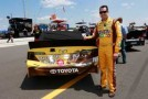 2013 NSCS Driver Kyle Busch Poses Next to His No. 18 M&Ms Toyota Camry - Photo Credit: Chris Trotman/Getty Images