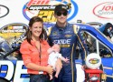 James Buescher, driver of the #31 Exide Chevrolet, poses with wife Kris and son Stetson after winning the NASCAR Camping World Truck Series Fan Appreciation 200 presented by New Holland at Iowa Speedway on September 8, 2013 in Newton, Iowa. - Photo Credit: Jennifer Stewart/Getty Images