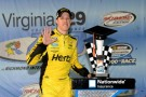 Brad Keselowski, driver of the #22 Hertz Ford, celebrates in Victory Lane after winning the NASCAR Nationwide Series Virginia 529 College Savings 250 at Richmond International Raceway on September 6, 2013 in Richmond, Virginia. - Photo Credit Patrick Smith/Getty Images