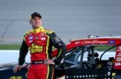 2013 NSCS Driver Clint Bowyer leaning on the No. 15 5-hour Energy Toyota Camry - Photo Credit: Streeter Lecka/Getty Images