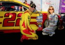 Joey Logano, driver of the #22 Shell-Pennzoil Ford, poses with Miss Coors Light Rachel Rupert and the pole award after qualifying for the NASCAR Sprint Cup Series Geico 400 at Chicagoland Speedway on September 13, 2013 in Joliet, Illinois. - Photo Credit: Sean Gardner/Getty Images