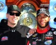 Darrell Wallace Jr., driver of the #54 ToyotaCare Toyota, and team owner Kyle Busch celebrate in victory lane after winning the NASCAR Camping World Truck Series Kroger 200 at Martinsville Speedway on October 26, 2013 in Martinsville, Virginia. - Photo Credit: Jerry Markland/Getty Images