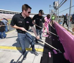 NASCAR drivers Brian Vickers and Matt Kenseth help more than 100 breast cancer survivors and supporters paint pit wall pink to kick off National Breast Cancer Awareness Month and preview the upcoming Dollar General 300 at Charlotte Motor Speedway on Oct. 11. (Photo Credit: CMS   /HHP photo)