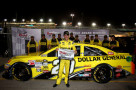 Matt Kenseth, driver of the #20 Dollar General Toyota, poses with the pole award after qualifying for the pole position in the NASCAR Sprint Cup Series Ford EcoBoost 400 at Homestead-Miami Speedway on November 15, 2013 in Homestead, Florida. - Photo Credit: Chris Trotman/Getty Images