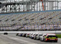 A group of cars are shown lined up on pit road during NASCAR Preseason Thunder at Daytona International Speedway on January 10, 2014 in Daytona Beach, Florida. - Photo Credit: NASCAR via Getty Images