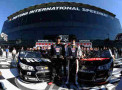 Austin Dillon, driver of the #3 DOW Chevrolet, and Martin Truex Jr., driver of the #78 Furniture Row Chevrolet, celebrate in Victory Lane after qualifying on the front row for the NASCAR Sprint Cup Series Daytona 500 at Daytona International Speedway on February 16, 2014 in Daytona Beach, Florida. Austin Dillon qualified for pole position and Martin Truex Jr. qualified second. - Photo Credit: Jared C. Tilton/Getty Images