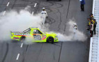 Matt Crafton, driver of the #88 Ideal Doors / Menards Toyota, celebrates with a burnout after winning the NASCAR Camping World Truck Series Kroger 250 at Martinsville Speedway on March 30, 2014 in Martinsville, Virginia. - Photo Credit: Jeff Curry/Getty Images