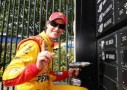 Joey Logano, driver of the #22 Shell-Pennzoil/Hertz Ford, drills his name on to the Wall of Champions after winning the NASCAR Sprint Cup Series Duck Commander 500 at Texas Motor Speedway on April 7, 2014 in Fort Worth, Texas. - Photo Credit: Chris Graythen/Getty Images