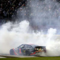 Jamie McMurray, driver of the #1 Bass Pro Chevrolet, celebrates with a burnout after winning the NASCAR Sprint Cup Series Sprint All-Star Race at Charlotte Motor Speedway on May 17, 2014 in Charlotte, North Carolina. - Photo Credit: Chris Graythen/Getty Images