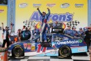 Elliott Sadler, driver of the #11 OneMain Financial Toyota, celebrates in Victory Lane after winning the NASCAR Nationwide Series Aaron's 312 at Talladega Superspeedway on May 3, 2014 in Talladega, Alabama. - Photo Credit: Jerry Markland/Getty Images