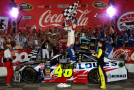 Jimmie Johnson, driver of the #48 Lowe's Patriotic Chevrolet, celebrates in victory lane after winning the NASCAR Sprint Cup Series Coca-Cola 600 at Charlotte Motor Speedway on May 25, 2014 in Charlotte, North Carolina. - Photo Credit: Jerry Markland/Getty Images