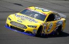 Marcos Ambrose, driver of the #9 Twisted Tea Ford, practices for the NASCAR Sprint Cup Series Coca-Cola 600 at Charlotte Motor Speedway on May 22, 2014 in Charlotte, North Carolina. - Photo Credit: Matt Sullivan/Getty Images