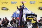 Denny Hamlin, driver of the #11 FedEx Express Toyota, celebrates in Victory Lane after winning the NASCAR Sprint Cup Series Aaron's 499 at Talladega Superspeedway on May 4, 2014 in Talladega, Alabama. - Photo Credit: Jerry Markland/Getty Images