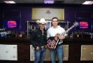 "Country Music star Justin Moore unveils John Wayne Walding as the winner of Crown Royal's ""Your Hero's Name Here"" with a custom guitar bearing the John Wayne Walding 400 logo at Bridgestone Arena on June 3, 2014 in Nashville, Tennessee. (Photo by Ilya S. Savenok/Getty Images for Crown Royal)"