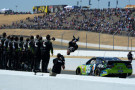 Carl Edwards, driver of the #99 Aflac Ford, celebrates with a backflip after winning the NASCAR Sprint Cup Series Toyota/Save Mart 350 at Sonoma Raceway on June 22, 2014 in Sonoma, California. - Photo Cedit: Robert Laberge/Getty Images