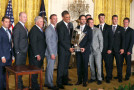 U.S. President Barack Obama (C) poses for a picture with the 2013 NASCAR Sprint Cup Series Champion Jimmie Johnson (5thR), team owner Rick Hendrick (3rd L), crew chief Chad Knaus (4th L), during an event in the East Room of the White House on June 25, 2014 in Washington, DC. Johnson was honored for winning his 6th Sprint Cup championship. - Photo Credit: Mark Wilson/Getty Images