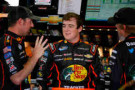 2014 NNS Driver Ty Dillon (center) speaks with his No. 3 Bass Pro Shops Chevy Crew - Photo Credit: Matt Sullivan/Getty Images