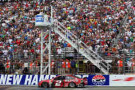 Brad Keselowski, driver of the #2 Redds Ford, comes to the finish line to win the NASCAR Sprint Cup Series Camping World RV Sales 301 at New Hampshire Motor Speedway on July 13, 2014 in Loudon, New Hampshire. - Photo Credit: Nick Laham/Getty Images