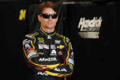 Jeff Gordon, driver of the #24 Axalta Chevrolet, looks on in the garage area during practice for the NASCAR Sprint Cup Series Crown Royal Presents The John Wayne Walding 400 at Indianapolis Motor Speedway on July 25, 2014 in Indianapolis, Indiana. - Photo Credit: Rainier Ehrhardt/Getty Images